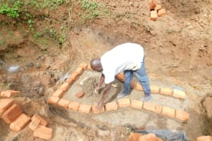 The Water Project: Mukhweso Community, Shemema Spring -  Bricklaying Begins