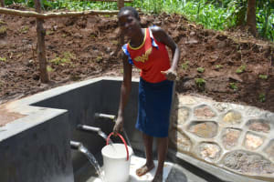 The Water Project: Mukhweso Community, Shemema Spring -  Esther Gives Thumbs Up At The Spring