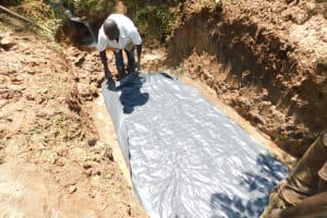 The Water Project: Mukhweso Community, Shemema Spring -  Laying Of Foundation