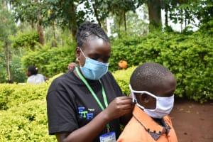 The Water Project: Mukhweso Community, Shemema Spring -  Putting On Masks
