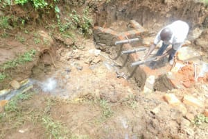 The Water Project: Mukhweso Community, Shemema Spring -  Setting The Pipes