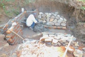 The Water Project: Mukhweso Community, Shemema Spring -  Stone Pitching