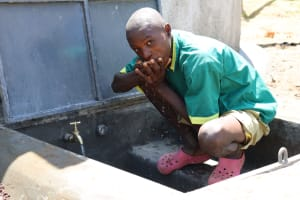 The Water Project: St. Peters Bwanga Primary School -  Brian Cools Off At The Rain Tank