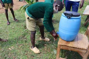 The Water Project: St. Peters Bwanga Primary School -  Eugine Washing His Hands
