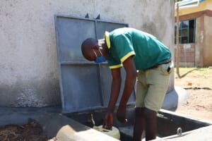 The Water Project: St. Peters Bwanga Primary School -  Fetching Water From The New Rain Tank