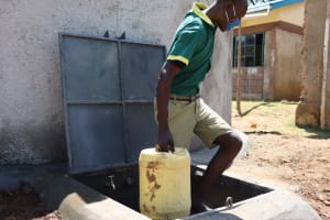 The Water Project: St. Peters Bwanga Primary School -  Leaving With Water From The Drawing Point