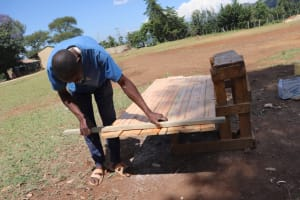The Water Project: St. Peters Bwanga Primary School -  Measuring And Realligning Latrine Doors
