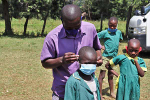 The Water Project: St. Peters Bwanga Primary School -  Nyundo Receives A Mask
