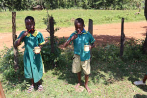 The Water Project: St. Peters Bwanga Primary School -  Rosoa And Jacob Demonstrate Toothbrushing