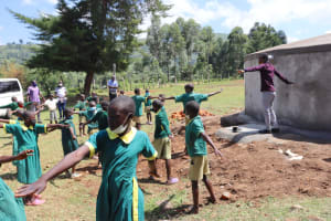 The Water Project: St. Peters Bwanga Primary School -  Trainer Ian Leads A Physical Distancing Check
