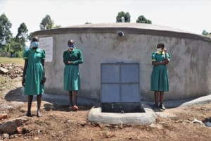 The Water Project: St. Peters Bwanga Primary School -  Girls Pose At The Waterpoint