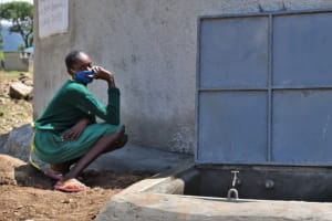 The Water Project: St. Peters Bwanga Primary School -  Student At The Rain Tank