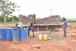 The Water Project: Kamuwongo Primary School -  Mixing Cement For Tank Walls