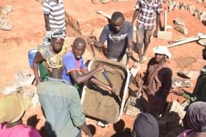 The Water Project: Kamuwongo Primary School -  Mixing Cement