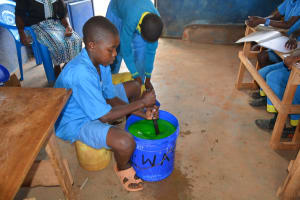 The Water Project: Kamuwongo Primary School -  Mixing Soap