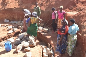 The Water Project: Kamuwongo Primary School -  Parents Work On Tank Foundation
