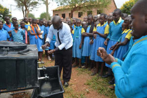 The Water Project: Kamuwongo Primary School -  Teacher Participates In Handwashing Demonstration