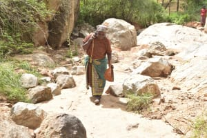The Water Project: Kithalani Community -  Carrying Water