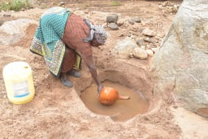The Water Project: Kithalani Community -  Collecting Water At The Open Source