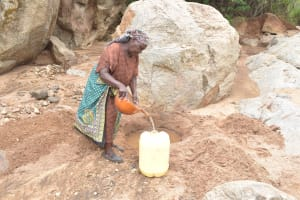 The Water Project: Kithalani Community -  Fetching Water