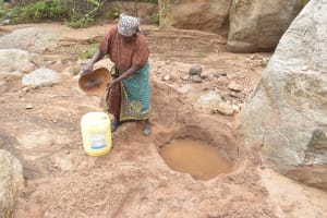 The Water Project: Kithalani Community -  Filling Container With Water