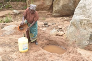 The Water Project: Kithalani Community -  Filling Up Container With Water From Open Source
