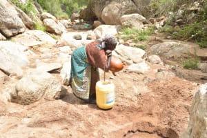 The Water Project: Kithalani Community -  Lifting Water Jug