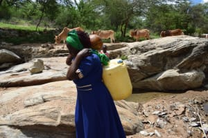 The Water Project: Lema Community A -  Carrying Water Home