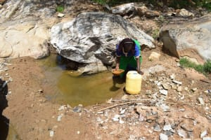 The Water Project: Lema Community A -  Filling Containter With Water