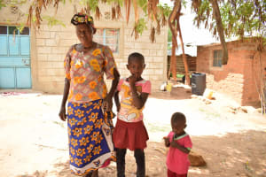The Water Project: Lema Community A -  Rose With Her Grandmother And Brother