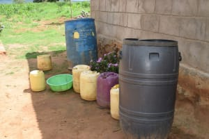 The Water Project: Lema Community -  Water Storage Containers Outside Of Home