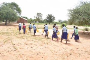 The Water Project: Mang'uu Primary School -  Students Carrying Water