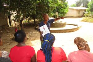 The Water Project: Lungi, New York, Robis, #7 Masata Lane -  Hygiene Facilitator Teaching About Bad Hygiene Pratices