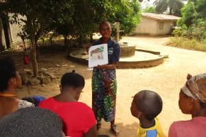 The Water Project: Lungi, New York, Robis, #7 Masata Lane -  Hygiene Facilitator Teaching About Bad Hygiene Practices