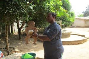 The Water Project: Lungi, New York, Robis, #7 Masata Lane -  Hygiene Facilitator Teaching About Diarrhea
