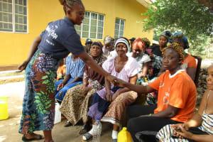 The Water Project: Lungi, New York, Robis, #7 Masata Lane -  Disease Transfer Through Handshaking Demonstration
