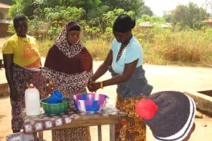The Water Project: Lungi, New York, Robis, #7 Masata Lane -  Training Participants Demostrate A Handwashing Method