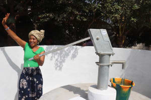 The Water Project: Lungi, New York, Robis, #7 Masata Lane -  Woman Collecting Safe Drinking Water