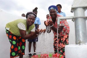 The Water Project: Lungi, International High School For Science & Technology -  Community Members Enjoying Clean Water