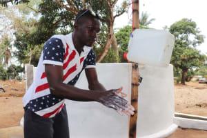 The Water Project: Lungi, Kamen, #22 Mission Road -  Youth Leader Abdulai M Kanu Demonstrating Handwashing