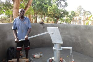 The Water Project: Lungi, Kamen, #22 Mission Road -  Community Member Collecting Water After Pump Installation