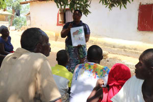 The Water Project: Lungi, Kamen, #22 Mission Road -  Hygiene Facilitator Teaching About Bad Hygiene Pratices