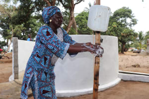 The Water Project: Lungi, Kamen, #22 Mission Road -  Section Chief Demonstrates Handwashing Before Dedication