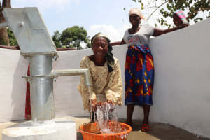 The Water Project: Lungi, Kamen, #22 Mission Road -  Woman Splashing Water