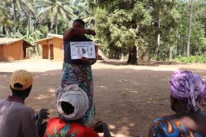 The Water Project: Lokomasama, Gbonkogbonko Village -  Hygiene Facilitator Taeching About Coronavirus