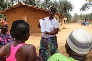 The Water Project: Lokomasama, Gbonkogbonko Village -  Hygiene Facilitator Teaching About Bathing