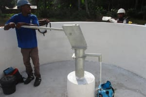 The Water Project: Lokomasama, Gbonkogbonko Village -  Maintenance Officer Collecting Water After Installing The Pump