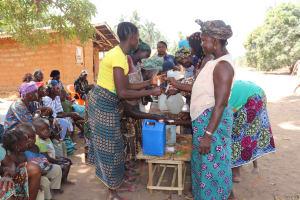 The Water Project: Lokomasama, Gbonkogbonko Village -  Participants Constructing Tippy Tap