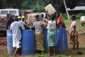 The Water Project: Lokomasama, Gbonkogbonko Village -  Community Members Collecting Water For Drilling