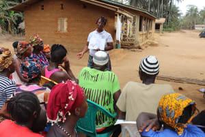 The Water Project: Lokomasama, Gbonkogbonko Village -  Hygiene Facilitator Teaching About Bad Hygiene Practices